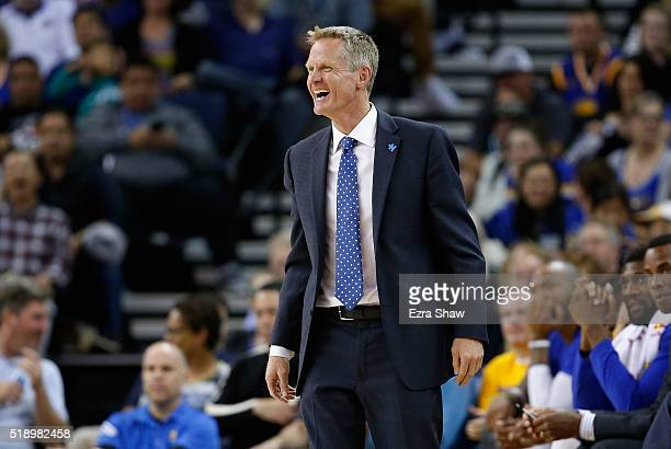 Head coach Steve Kerr of the Golden State Warriors smiles on the bench during their game against the Portland Trail Blazers at ORACLE Arena on April...
