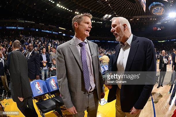Head Coach Steve Kerr of the Golden State Warriors speaks with Head Coach Gregg Popovich of the San Antonio Spurs after the game on February 20 2015...