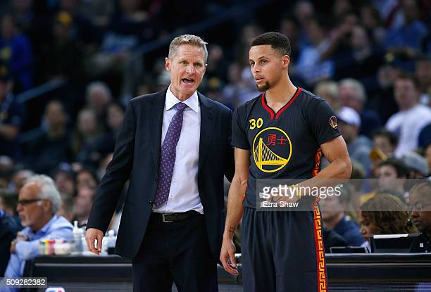 Head coach Steve Kerr of the Golden State Warriors talks to Stephen Curry during their game against the Houston Rockets at ORACLE Arena on February 9...