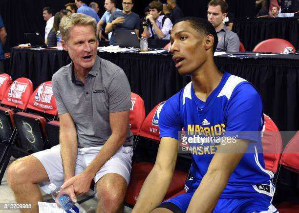 Head coach Steve Kerr of the Golden State Warriors talks with Patrick McCaw of the Warriors after the team defeated the Minnesota Timberwolves 7769...