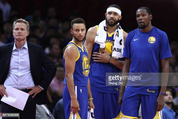 Head coach Steve Kerr Stephen Curry Kevin Durant and JaVale McGee of the Golden State Warriors look on during react the game between the Minnesota...