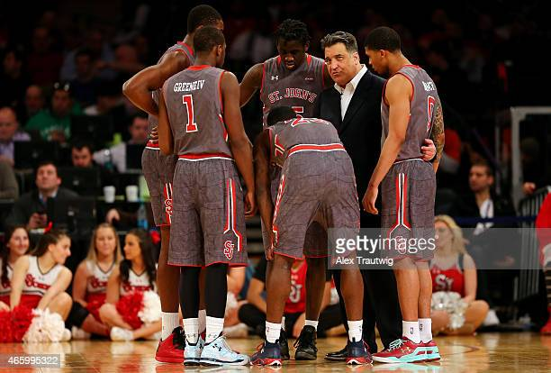 Head coach Steve Lavin of the St John's Red Storm huddles with his players in the second half against the Providence Friars during a quarterfinal...