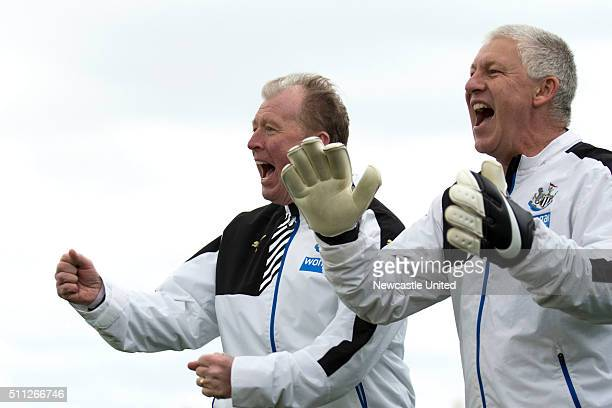 Head coach Steve McClaren of Newcastle United celebrates begind goalkeeping coach Simon Smith during a Newcastle United Training session at the the...