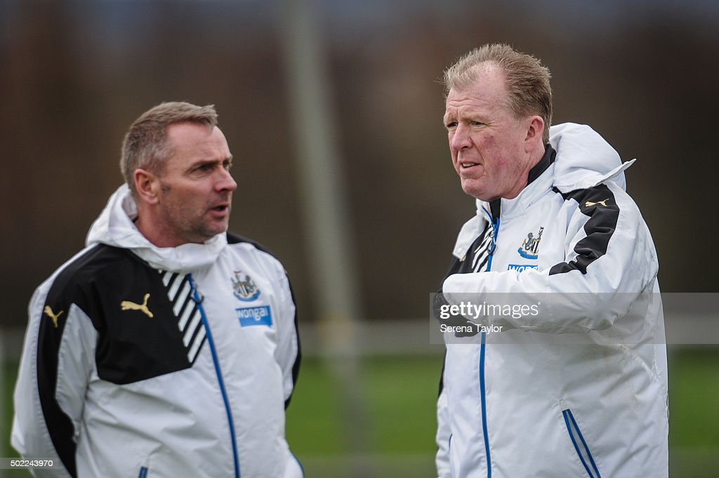 Head Coach Steve McClaren (R) talks to Assistant Coach Paul Simpson (L) during the Newcastle United Training session at The Newcastle United Training Centre on December 22, 2015, in Newcastle upon Tyne, England.