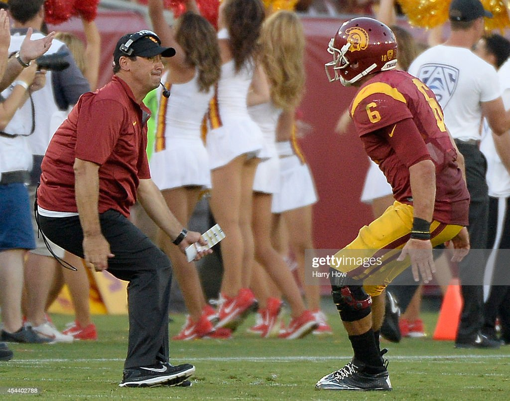 Head Coach <a gi-track='captionPersonalityLinkClicked' href=/galleries/search?phrase=Steve+Sarkisian&family=editorial&specificpeople=3908466 ng-click='$event.stopPropagation()'>Steve Sarkisian</a> celebrates a touchdown with <a gi-track='captionPersonalityLinkClicked' href=/galleries/search?phrase=Cody+Kessler&family=editorial&specificpeople=9870723 ng-click='$event.stopPropagation()'>Cody Kessler</a> #6 for a 52-13 lead over the Fresno State Bulldogs during the third quarter at Los Angeles Memorial Coliseum on August 30, 2014 in Los Angeles, California.