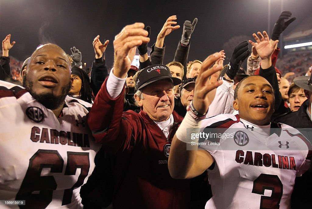 Head coach <a gi-track='captionPersonalityLinkClicked' href=/galleries/search?phrase=Steve+Spurrier&family=editorial&specificpeople=228031 ng-click='$event.stopPropagation()'>Steve Spurrier</a> celebrates with his team after defeating the Clemson Tigers 27-17 at Memorial Stadium on November 24, 2012 in Clemson, South Carolina.