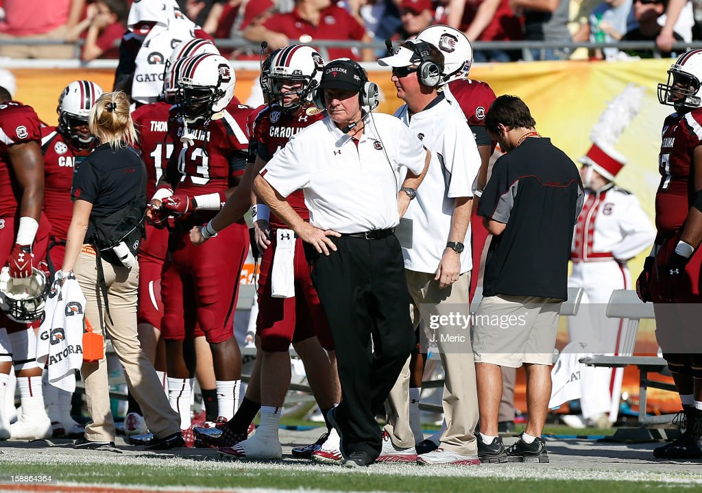 Head coach <a gi-track='captionPersonalityLinkClicked' href=/galleries/search?phrase=Steve+Spurrier&family=editorial&specificpeople=228031 ng-click='$event.stopPropagation()'>Steve Spurrier</a> of the South Carolina Gamecocks directs his team against the Michigan Wolverines during the Outback Bowl Game at Raymond James Stadium on January 1, 2013 in Tampa, Florida.