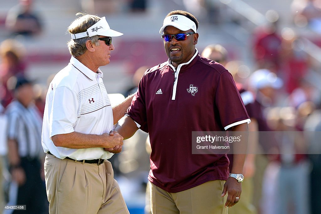Head coach Steve Spurrier of the South Carolina Gamecocks , left, shakes hands with head coach Kevin Sumlin of the Texas A&M Aggies before their game at Williams-Brice Stadium on August 28, 2014 in Columbia, South Carolina.
