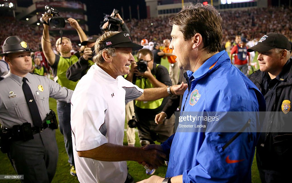 Head coach Steve Spurrier of the South Carolina Gamecocks shakes hands with head coach Will Muschamp of the Florida Gators after their game at...
