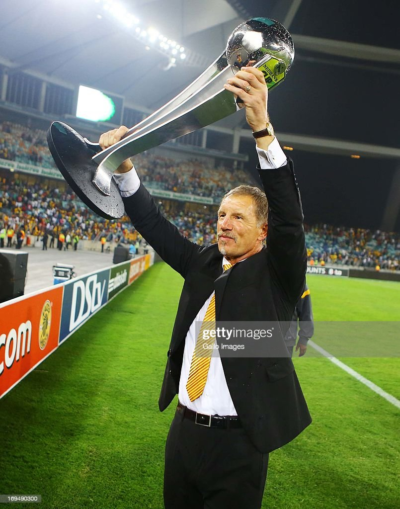 Head coach Stuart Baxter of the Chiefs celebrates with the trophy after the Nedbank Cup Final between SuperSport United and Kaizer Chiefs at Moses...