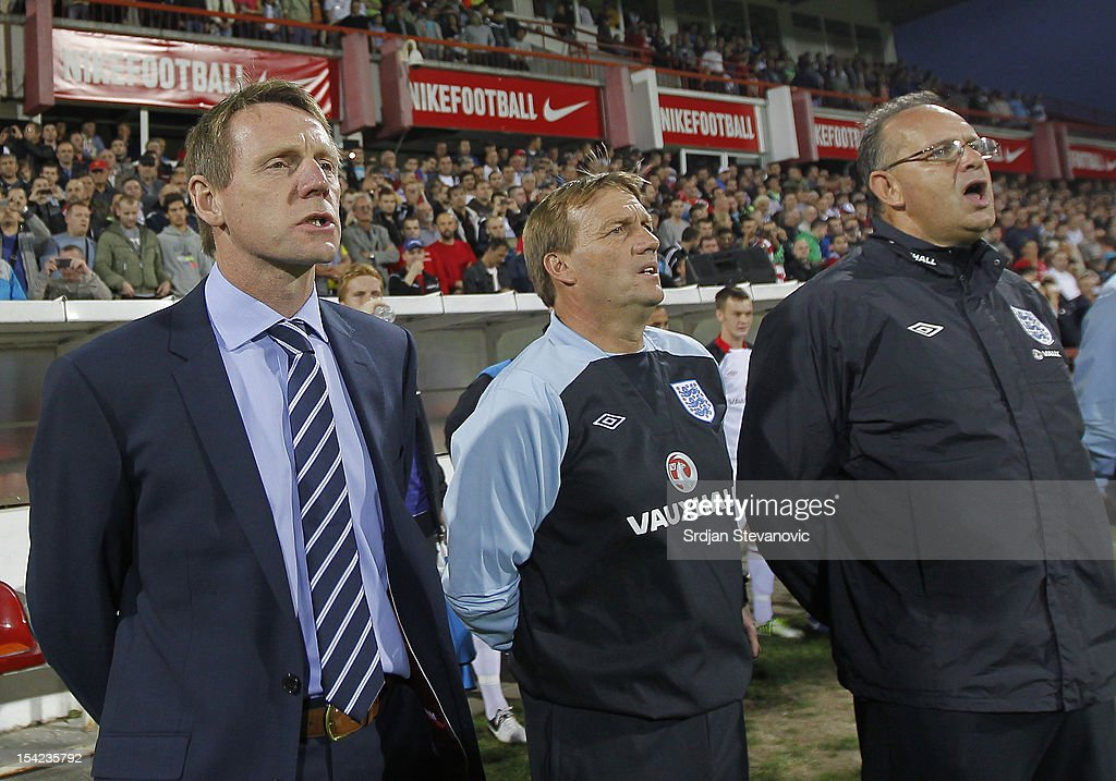Head coach Stuart Pearce (L) of England and assistant Steve Wigley sing the national anthem prior the Under 21 European Championship Play Off second leg match between Serbia U21 and England U21 at Stadium Mladost on October 16, 2012 in Krusevac, Serbia.