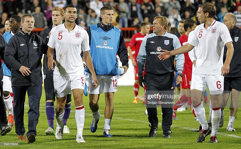 Head Coach <a gi-track='captionPersonalityLinkClicked' href=/galleries/search?phrase=Stuart+Pearce&family=editorial&specificpeople=213348 ng-click='$event.stopPropagation()'>Stuart Pearce</a> of England and his assistant <a gi-track='captionPersonalityLinkClicked' href=/galleries/search?phrase=Steve+Wigley&family=editorial&specificpeople=228321 ng-click='$event.stopPropagation()'>Steve Wigley</a> lead <a gi-track='captionPersonalityLinkClicked' href=/galleries/search?phrase=Steven+Caulker&family=editorial&specificpeople=6527106 ng-click='$event.stopPropagation()'>Steven Caulker</a>, Craig Dawson, Ryan Bennett and the rest of his team off the pitch after the Under 21 European Championship Play Off second leg match between Serbia U21 and England U21 at Stadium Mladost on October 16, 2012 in Krusevac, Serbia.