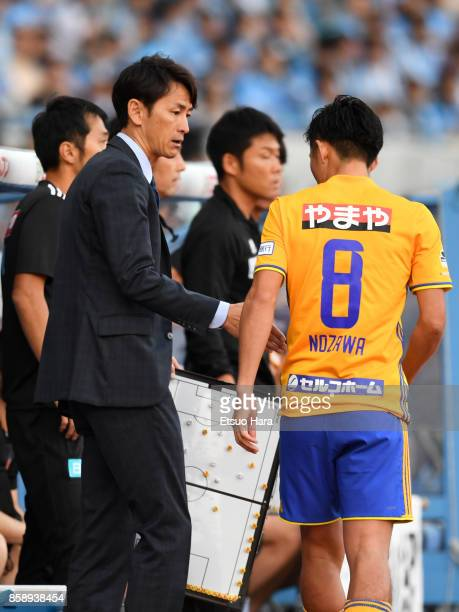 Head coach Susumu Watanabe of Vegalta Sendai gives instruction to his player during the JLeague Levain Cup semi final second leg match between...