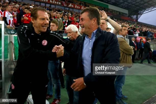 Head coach Sven Demandt of Essen welcomes head coach Dieter Hecking of Mnchengladbach prior to the DFB Cup first round match between RotWeiss Essen...