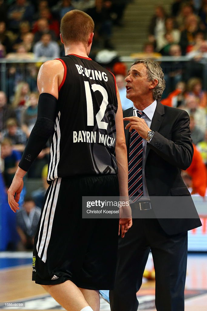 Head coach Svetislav Pesic of Bayern Muenchen (R) speaks to Robin Benzig of Bayern Muenchen (L) during the Beko BBL Bundesliga match between Phoenix Hagen and FC Bayern Muenchen at ENERVIE Arena on December 22, 2011 in Hagen, Germany.