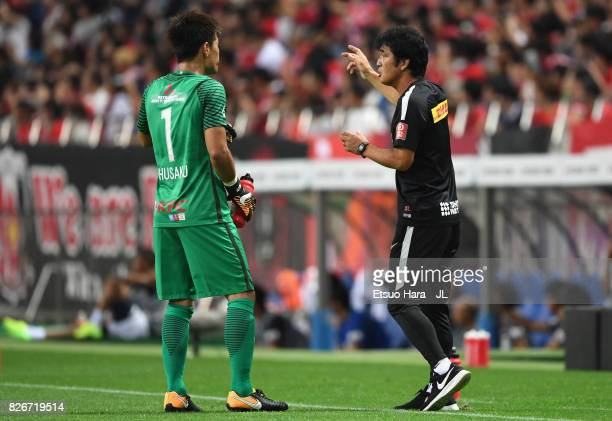 Head coach Takafumi Hori of Urawa Red Diamonds gives instruction to Shusaku Nishikawa during the JLeague J1 match between Urawa Red Diamonds and...