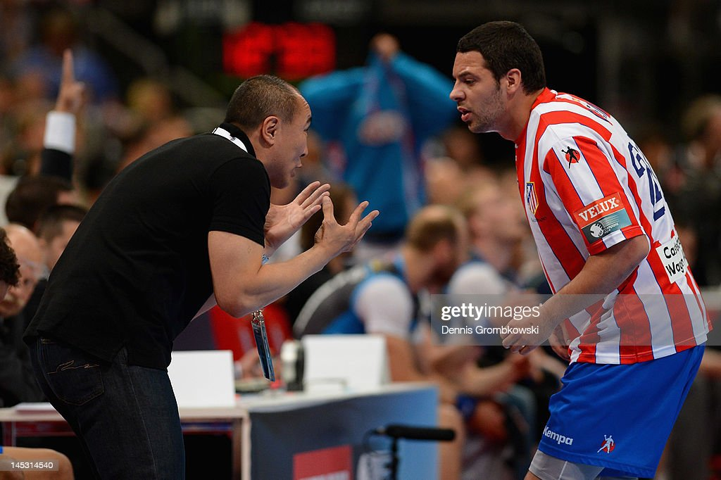 Head coach Talant Dujshebaev of Madrid talks to <a gi-track='captionPersonalityLinkClicked' href=/galleries/search?phrase=Alberto+Entrerrios&family=editorial&specificpeople=727583 ng-click='$event.stopPropagation()'>Alberto Entrerrios</a> during the EHF Final Four semi final match between BM Athletico Madrid and AG Kobenhavn at Lanxess Arena on May 26, 2012 in Cologne, Germany. at Lanxess Arena on May 26, 2012 in Cologne, Germany.