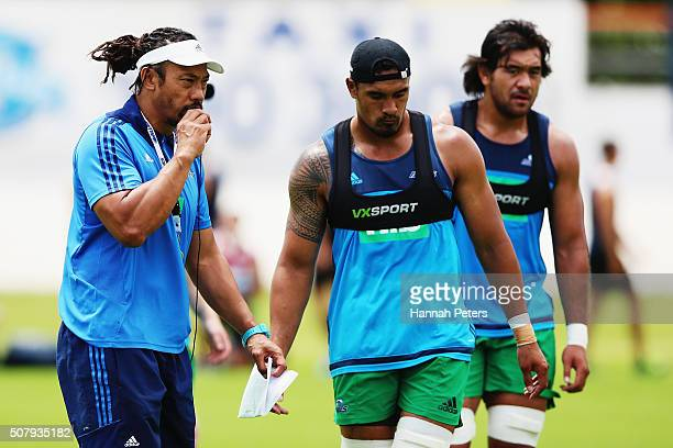Head coach Tana Umaga of the Blues blows his whistle as Jerome Kaino runs through drills during a Blues super rugby training session at Alexander...