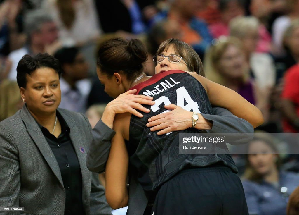 Head coach Tara VanDerveer of the Stanford Cardinal embraces player Erica McCall #24 after their 53-62 loss to the South Carolina Gamecocks during the semifinal round of the 2017 NCAA Women's Final Four at American Airlines Center on March 31, 2017 in Dallas, Texas.