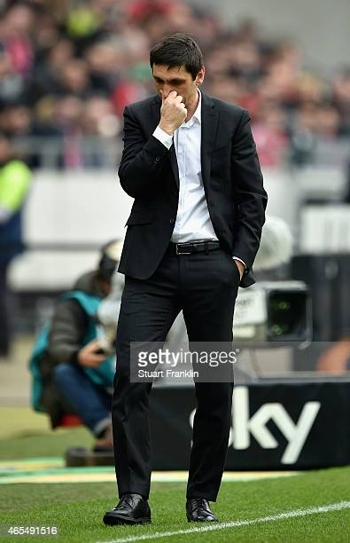 Head coach Tayfun Korkut of Hannover 96 reacts during the Bundesliga match between Hannover 96 and FC Bayern Muenchen at HDIArena on March 7 2015 in...
