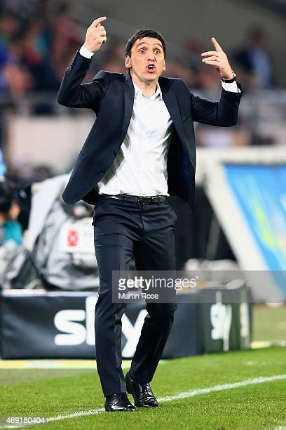 Head coach Tayfun Korkut of Hannover 96 reacts during the Bundesliga match between Hannover 96 and Hertha BSC at HDIArena on April 10 2015 in Hanover...