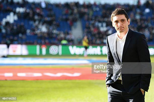Head coach Tayfun Korkut of Hannover is seen prior to the Bundesliga match between Hannover 96 and VfB Stuttgart at HDIArena on February 28 2015 in...