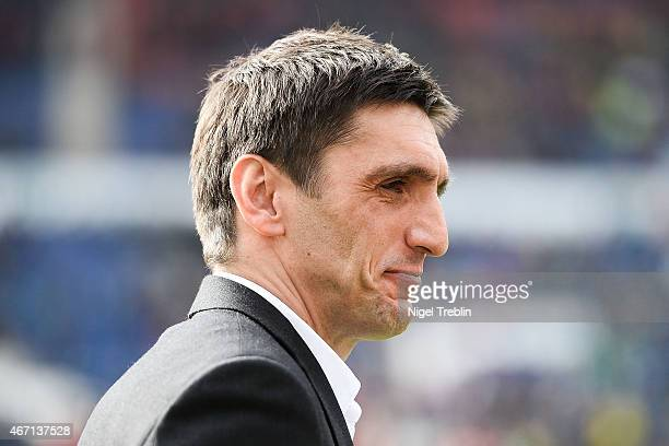 Head coach Tayfun Korkut of Hannover looks on prior to the Bundesliga match between Hannover 96 and Borussia Dortmund at HDIArena on March 21 2015 in...