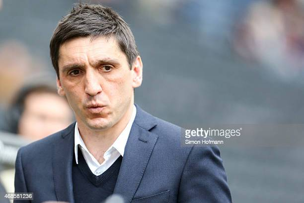 Head coach Tayfun Korkut of Hannover looks on prior to the Bundesliga match between Eintracht Frankfurt and Hannover 96 at CommerzbankArena on April...