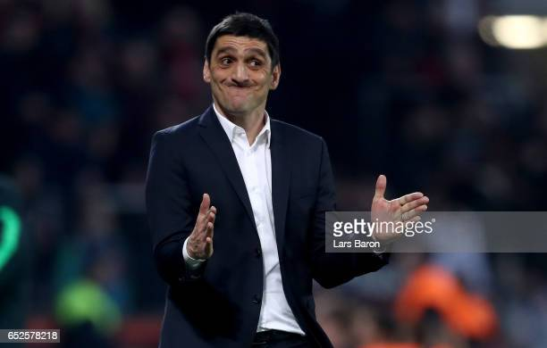 Head coach Tayfun Korkut of Leverkusen gestures during the Bundesliga match between Bayer 04 Leverkusen and Werder Bremen at BayArena on March 10...