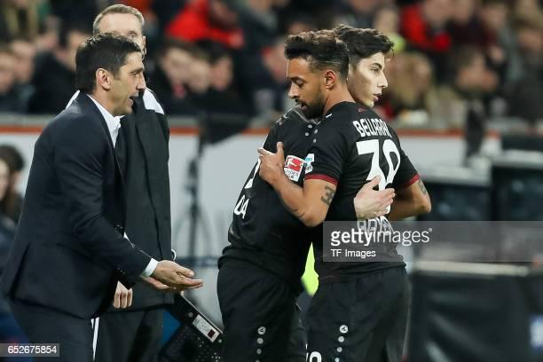 Head coach Tayfun Korkut of Leverkusen Kai Havertz of Leverkusen and Karim Bellarabi during the Bundesliga soccer match between Bayer Leverkusen and...