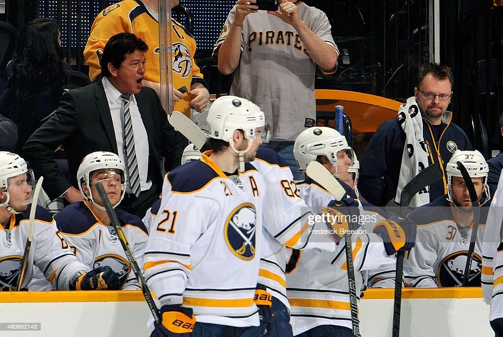 Head coach Ted Nolan of the Buffalo Sabres directs his team during a timeout in a game against the Nashville Predators at Bridgestone Arena on March...
