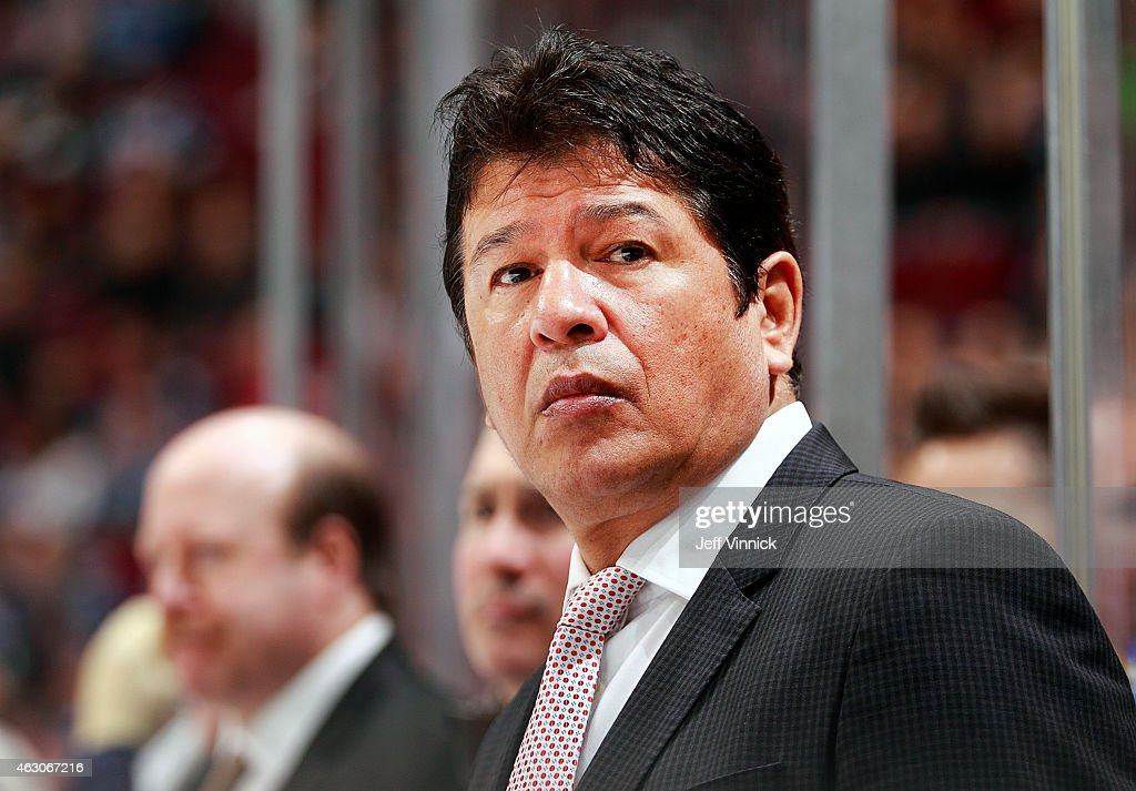 Head coach Ted Nolan of the Buffalo Sabres looks on from the bench during their NHL game against the Vancouver Canucks at Rogers Arena January 30...