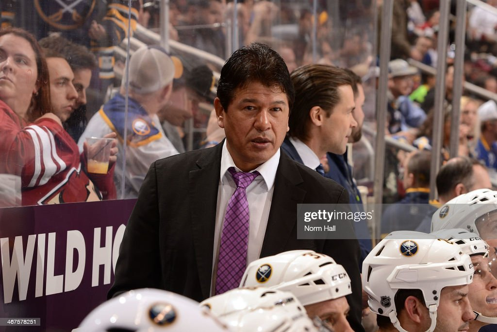 Head Coach Ted Nolan of the Buffalo Sabres looks on from the bench against the Phoenix Coyotes at Jobingcom Arena on January 30 2014 in Glendale...