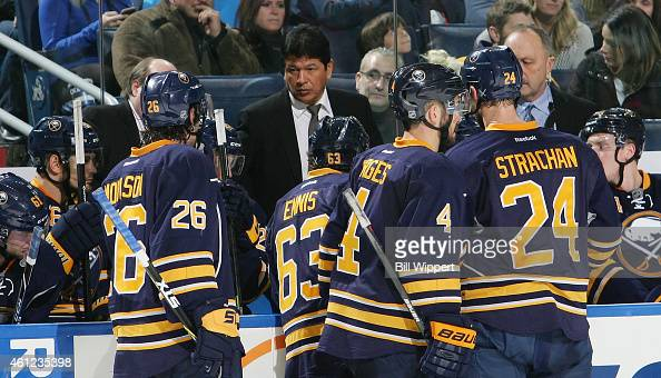 Head coach Ted Nolan of the Buffalo Sabres talks to players during a game against the Florida Panthers on January 2 2015 at the First Niagara Center...