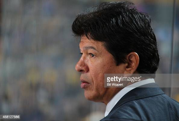 Head coach Ted Nolan of the Buffalo Sabres watches first period action against the Boston Bruins on October 30 2014 at the First Niagara Center in...