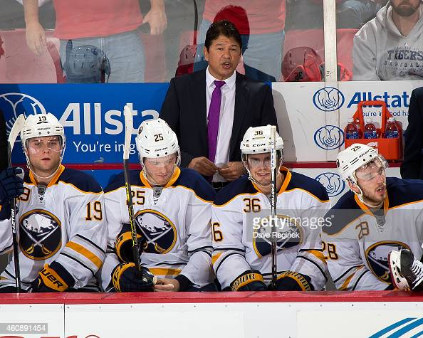 Head coach Ted Nolan of the Buffalo Sabres watches the action from the bench during a NHL game against the Detroit Red Wings on December 23 2014 at...