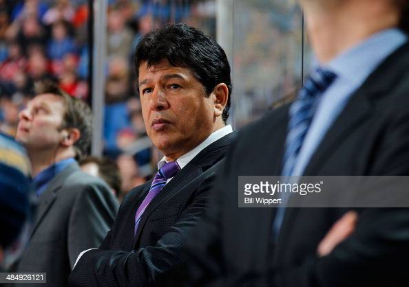 Head coach Ted Nolan of the Buffalo Sabres watches their game against the New Jersey Devils on April 1 2014 at the First Niagara Center in Buffalo...