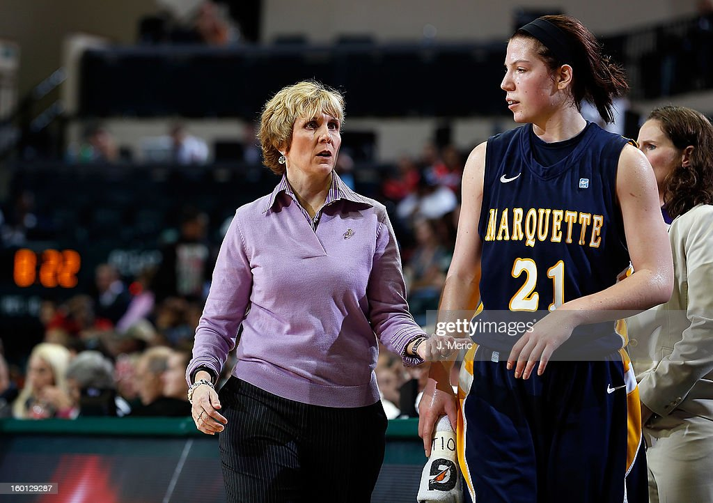 Head coach Terri Mitchell of the Marquette Golden Eagles talks with Katherine Plouffe #21 during the game against the South Florida Bulls at the Sun Dome on January 26, 2013 in Tampa, Florida.