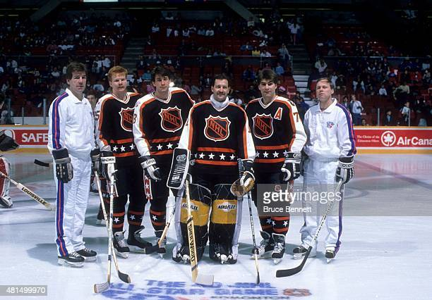 Head coach Terry O'Reilly Glen Wesley Cam Neely goalie Reggie Lemelin and Ray Bourque of the Wales Conference and the Boston Bruins pose for a...