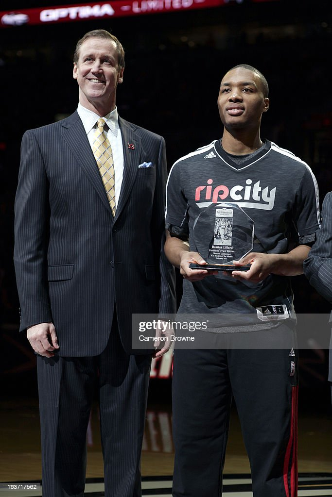 Head Coach Terry Stotts and Damian Lillard #0 of the Portland Trail Blazers accept the Rookie of the Month award from KIA prior to the game against the New York Knicks on March 14, 2013 at the Rose Garden Arena in Portland, Oregon.