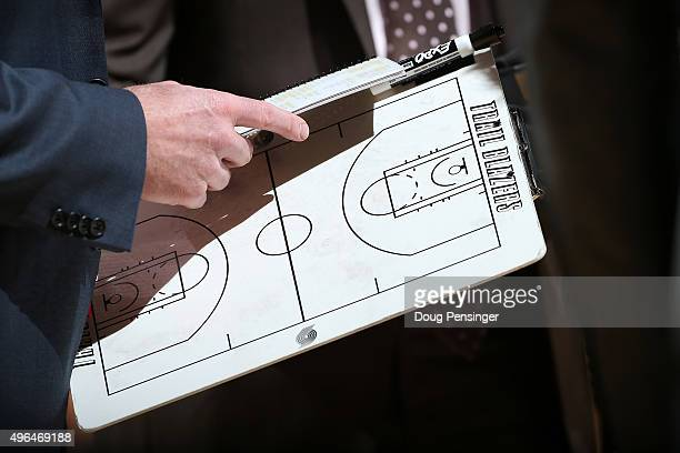 Head coach Terry Stotts of the Portland Trail Blazers holds the clipboard during a time out as he leads his team against the Denver Nuggets at Pepsi...
