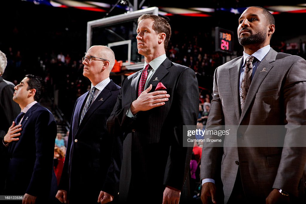 Head Coach Terry Stotts of the Portland Trail Blazers listens to the National Anthem before a game against the Charlotte Bobcats on March 4, 2013 at the Rose Garden Arena in Portland, Oregon.