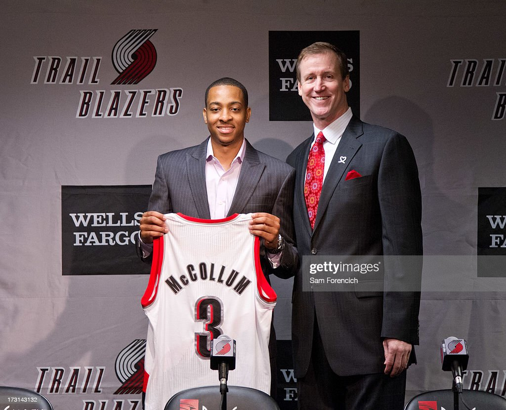 Head coach Terry Stotts of the Portland Trail Blazers poses for a photo with NBA draft pick C.J. McCollum of the Portland Trail Blazers during a press conference July 8, 2013 at the Rose Garden Arena in Portland, Oregon.