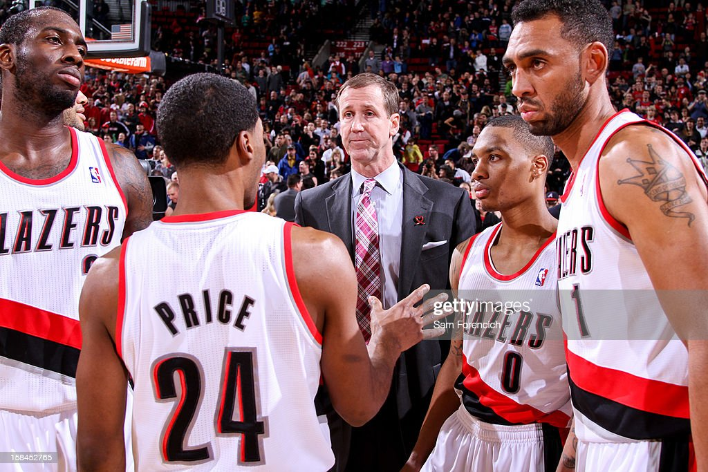 Head Coach Terry Stotts of the Portland Trail Blazers speaks to players, from left, J.J. Hickson #21, Ronnie Price #24, Damian Lillard #0 and Jared Jeffries #1 before resuming action against the New Orleans Hornets on December 16, 2012 at the Rose Garden Arena in Portland, Oregon.