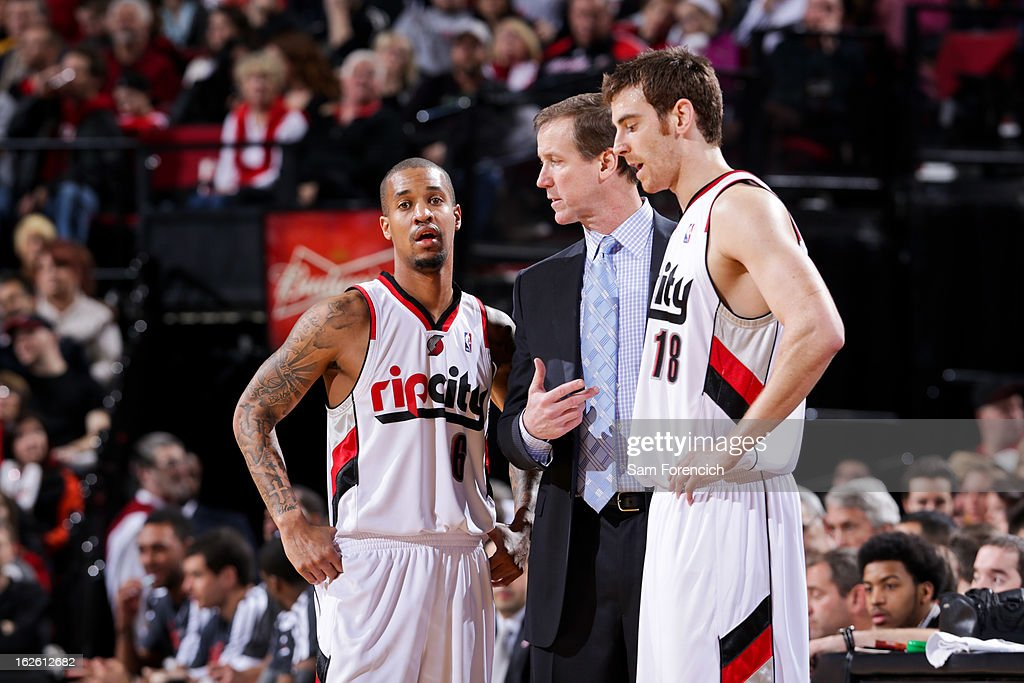 Head Coach Terry Stotts of the Portland Trail Blazers speaks with Eric Maynor #6 and Victor Claver #18 during a game against the Boston Celtics on February 24, 2013 at the Rose Garden Arena in Portland, Oregon. This was Maynor's debut game for the team.