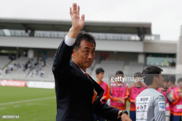 Head coach Tetsuya Asano of AC Nagano Parceiro applauds supporters after his side's 21 victory in the JLeague J3 match between AC Nagano Parceiro and...