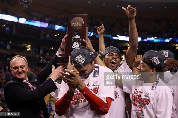 Head coach Thad Matta and the Ohio State Buckeyes celebrate after defeating the Syracuse Orange during the 2012 NCAA Men's Basketball East Regional...