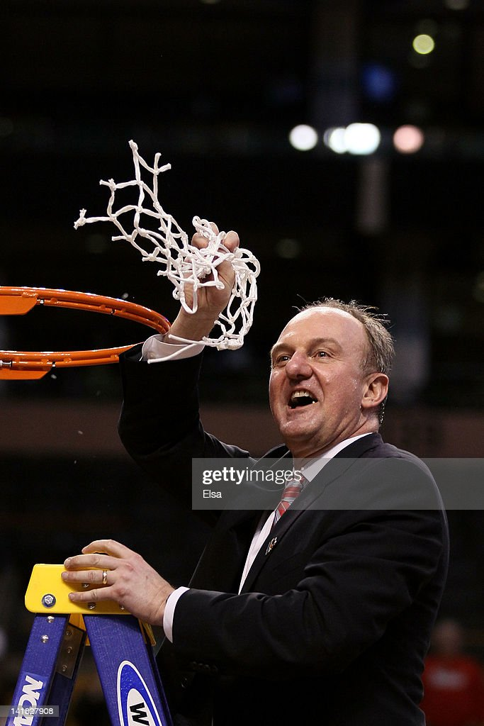 Head coach <a gi-track='captionPersonalityLinkClicked' href=/galleries/search?phrase=Thad+Matta&family=editorial&specificpeople=799910 ng-click='$event.stopPropagation()'>Thad Matta</a> and the Ohio State Buckeyes cuts down the net after defeating the Syracuse Orange during the 2012 NCAA Men's Basketball East Regional Final at TD Garden on March 24, 2012 in Boston, Massachusetts.