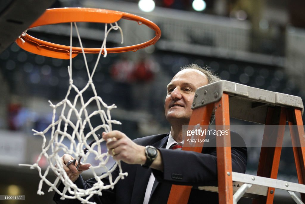 Head coach <a gi-track='captionPersonalityLinkClicked' href=/galleries/search?phrase=Thad+Matta&family=editorial&specificpeople=799910 ng-click='$event.stopPropagation()'>Thad Matta</a> of the Ohio State Buckeyes celebrates after he cut down the net following their 71-60 win against the Penn State Nittany Lions during the championship game of the 2011 Big Ten Men's Basketball Tournament at Conseco Fieldhouse on March 13, 2011 in Indianapolis, Indiana.