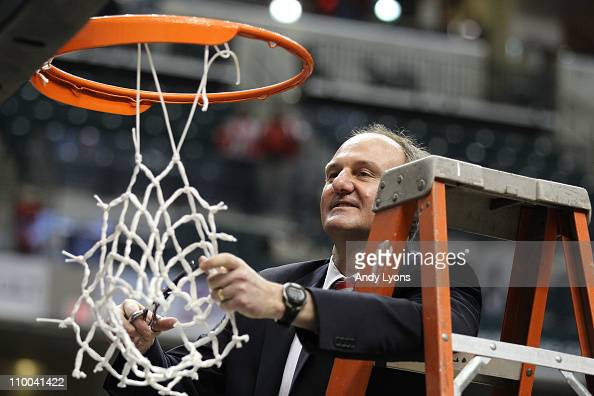 Head coach Thad Matta of the Ohio State Buckeyes celebrates after he cut down the net following their 7160 win against the Penn State Nittany Lions...